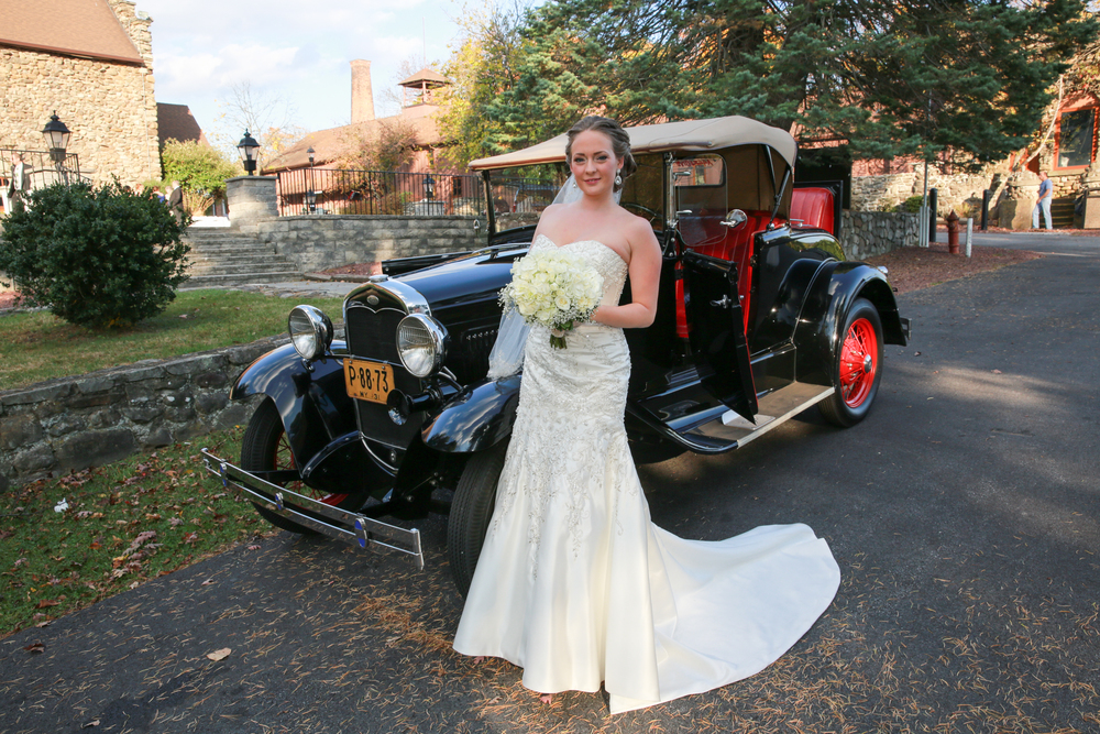 photo of wedding with antique car.