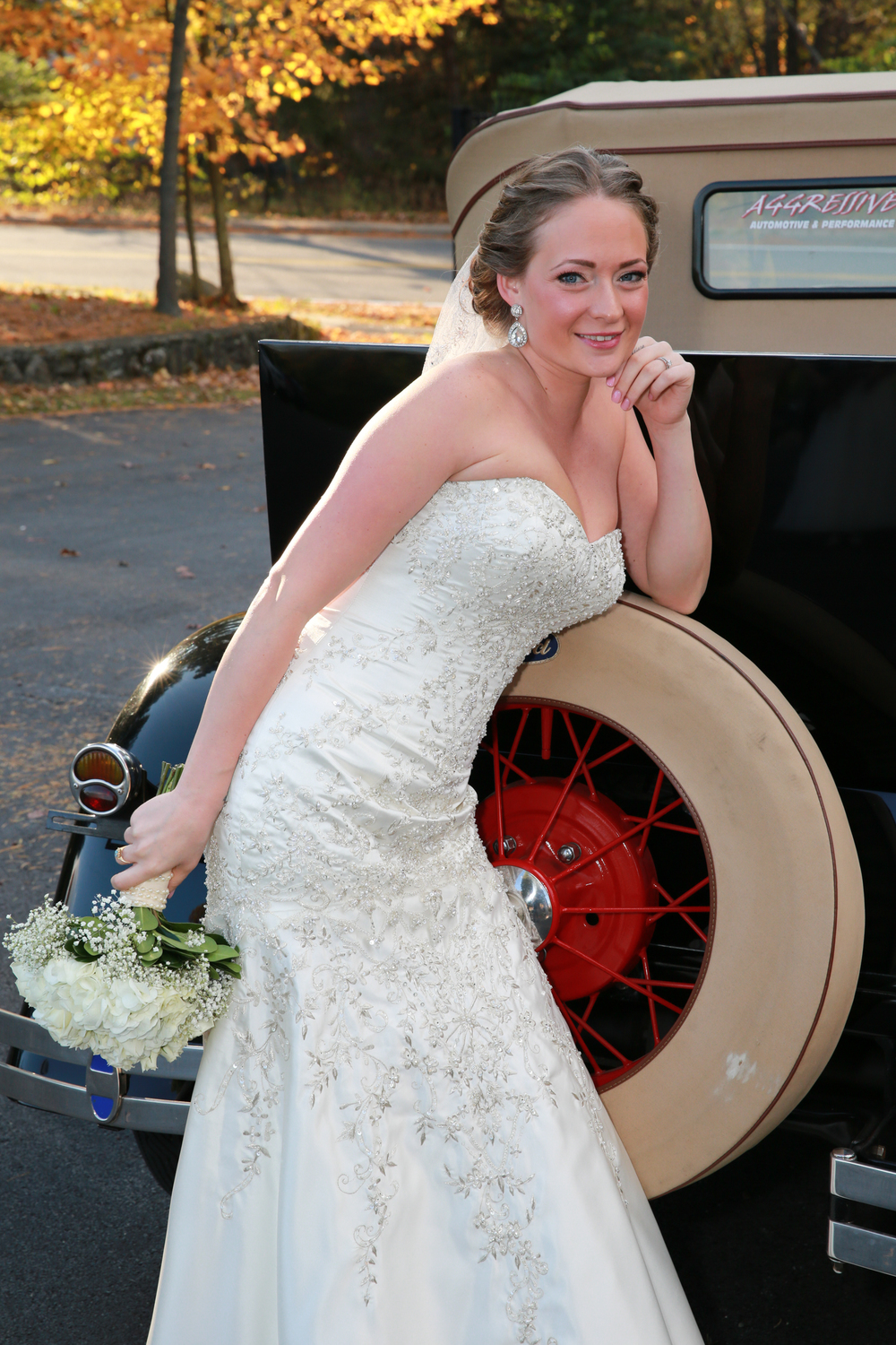 Bride having fun with antique car
