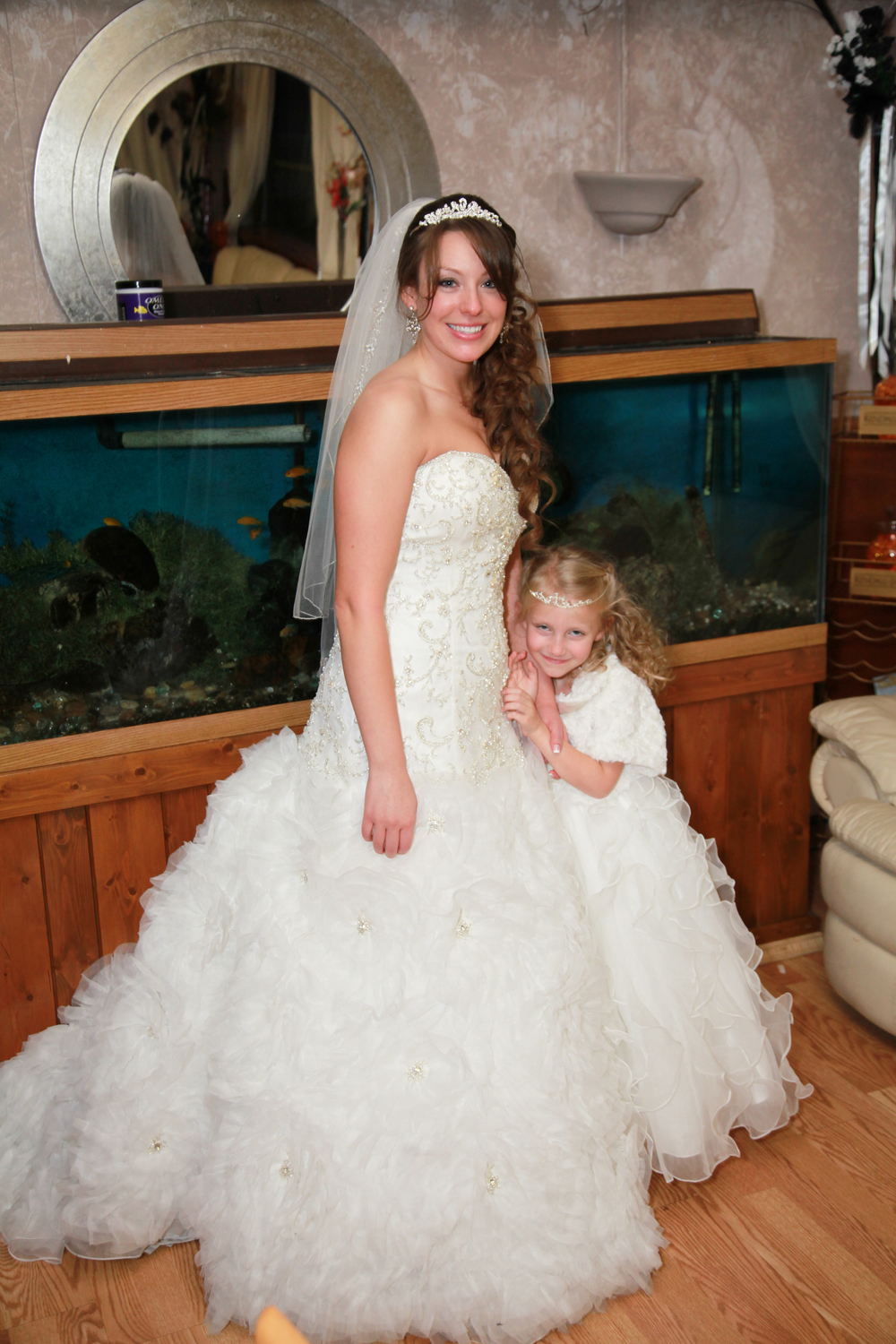 Beautful bride photographed with her flower girl at the