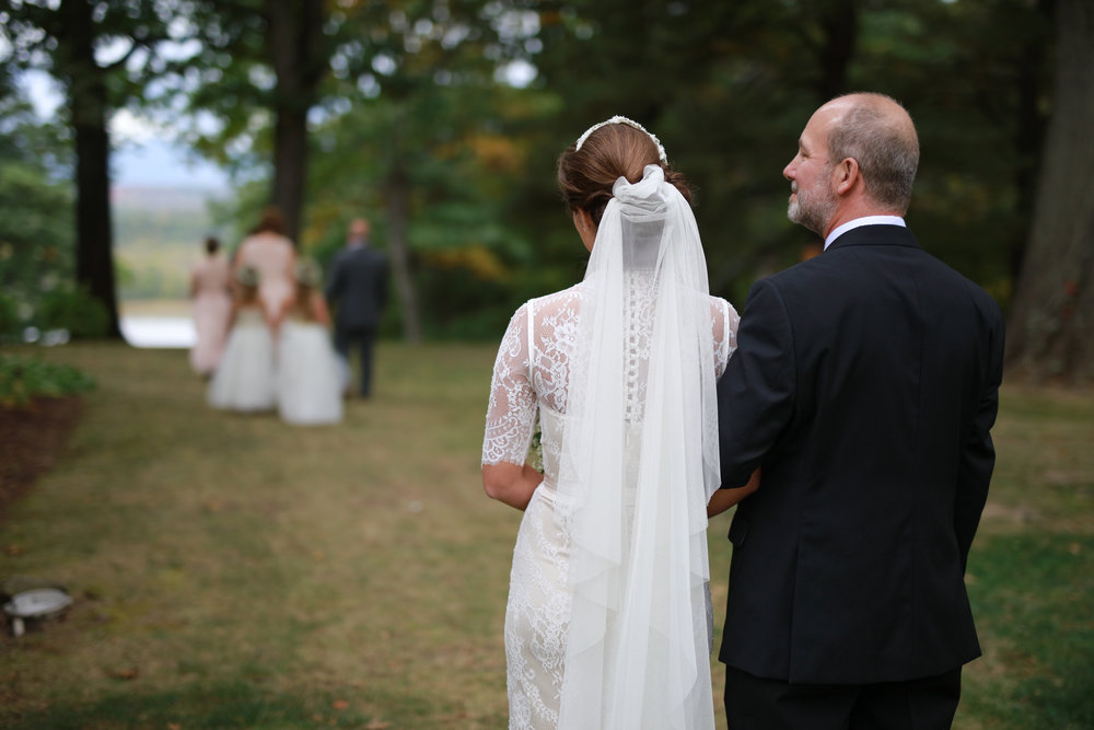 Photo of a father and daughter right before walking down the aisle