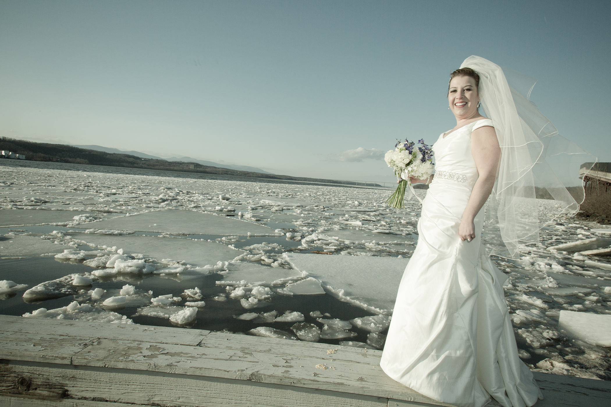 Bride walking along the Hudson River