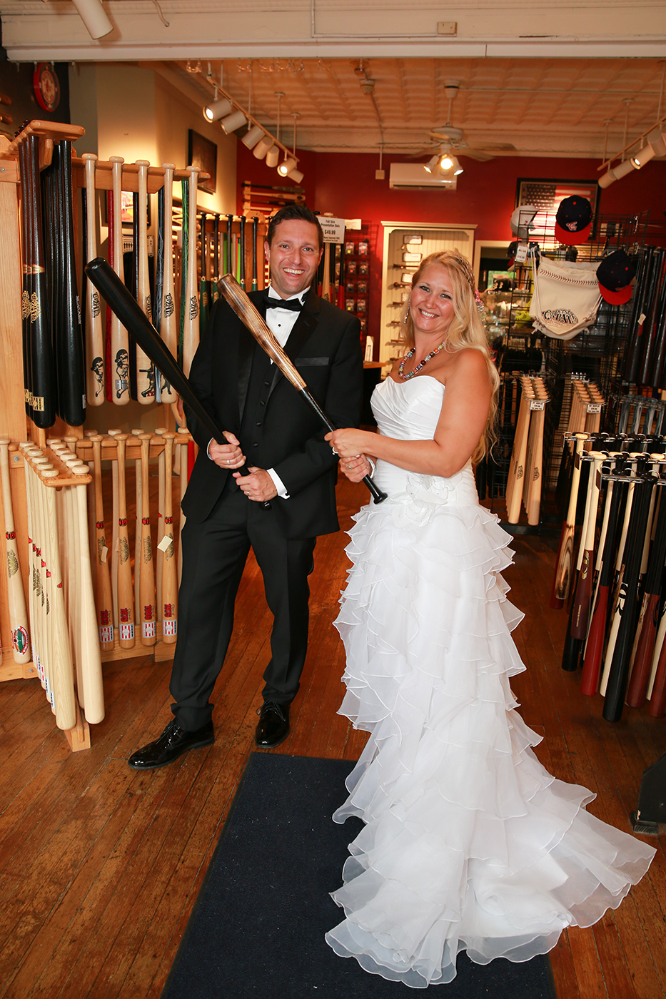 Bride abd Groom picking out their bats