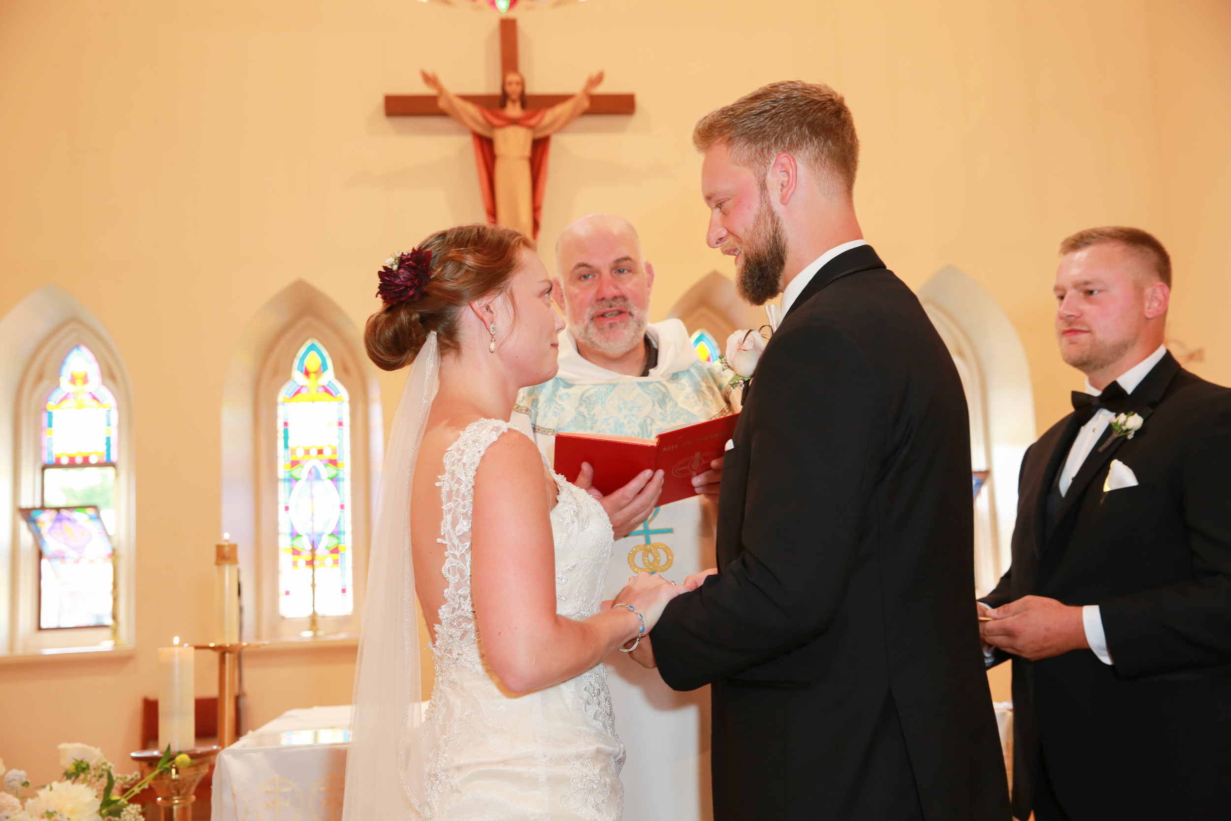 Bride and Groom during wedding vows at St. Mary's in Saugerties, NY
