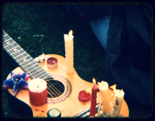 """This is my first guitar being violated years later at the Kurt Cobain (""""why Curt, why?"""") vigil in 1994. I turned my back for 2 mins, and my mate Al lit a candle on it, and then others followed suit."""