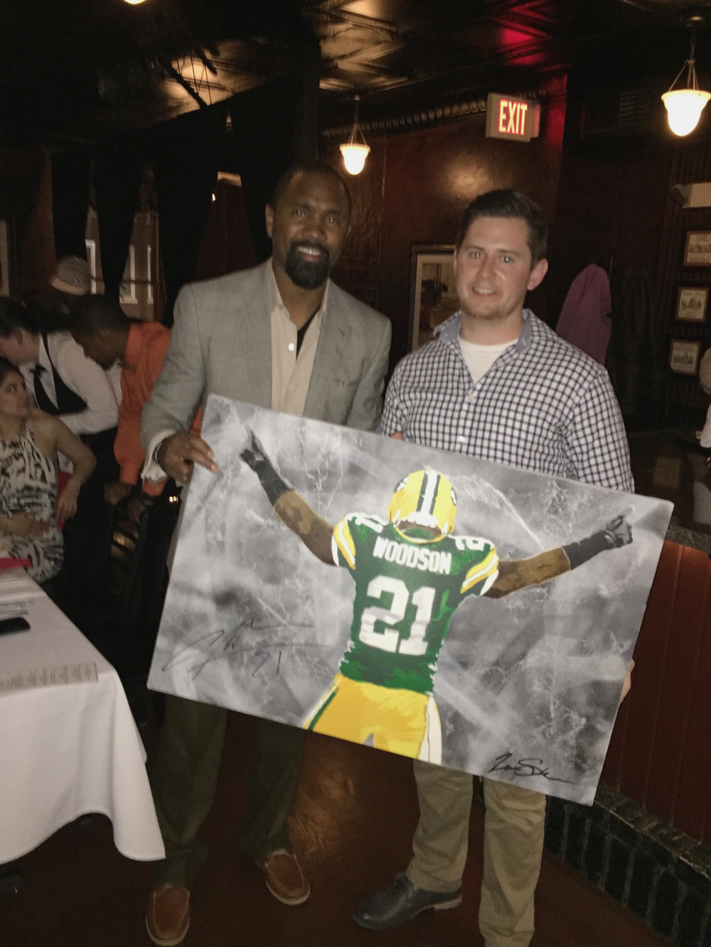 Charles Woodson Holding Painting.jpg