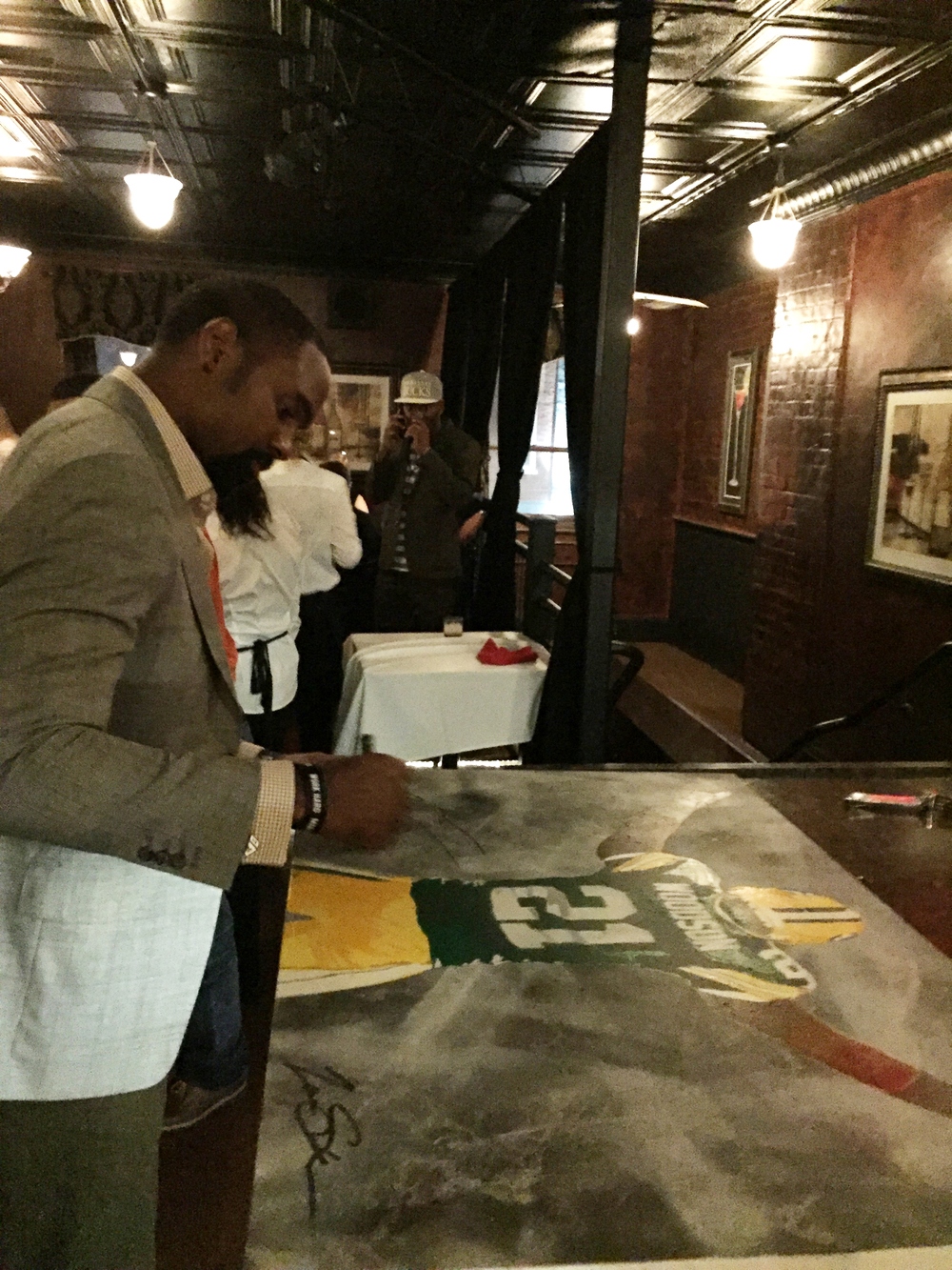 Charles Woodson_Signing Painting.jpg