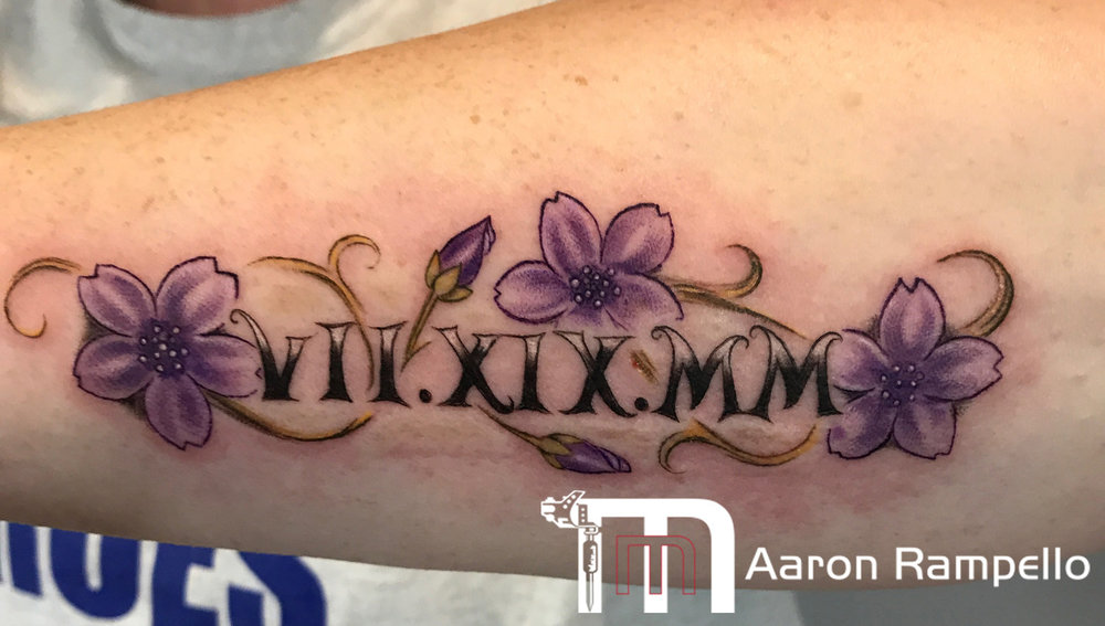 RomanNumerals-Flower+Tattoo.jpg
