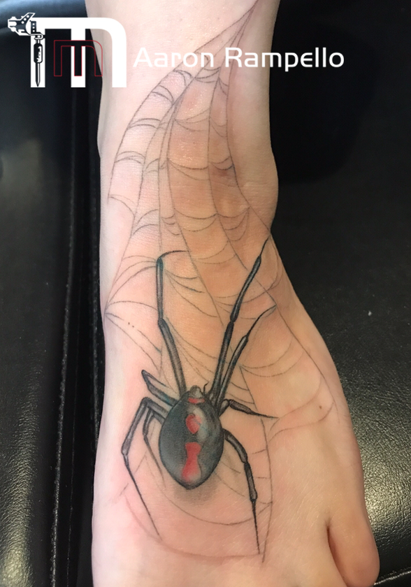 spider on foot tattoo.jpg