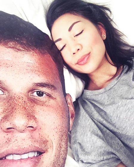 This is me laying peacefully next to a giant cardboard cutout of Blake Griffin.