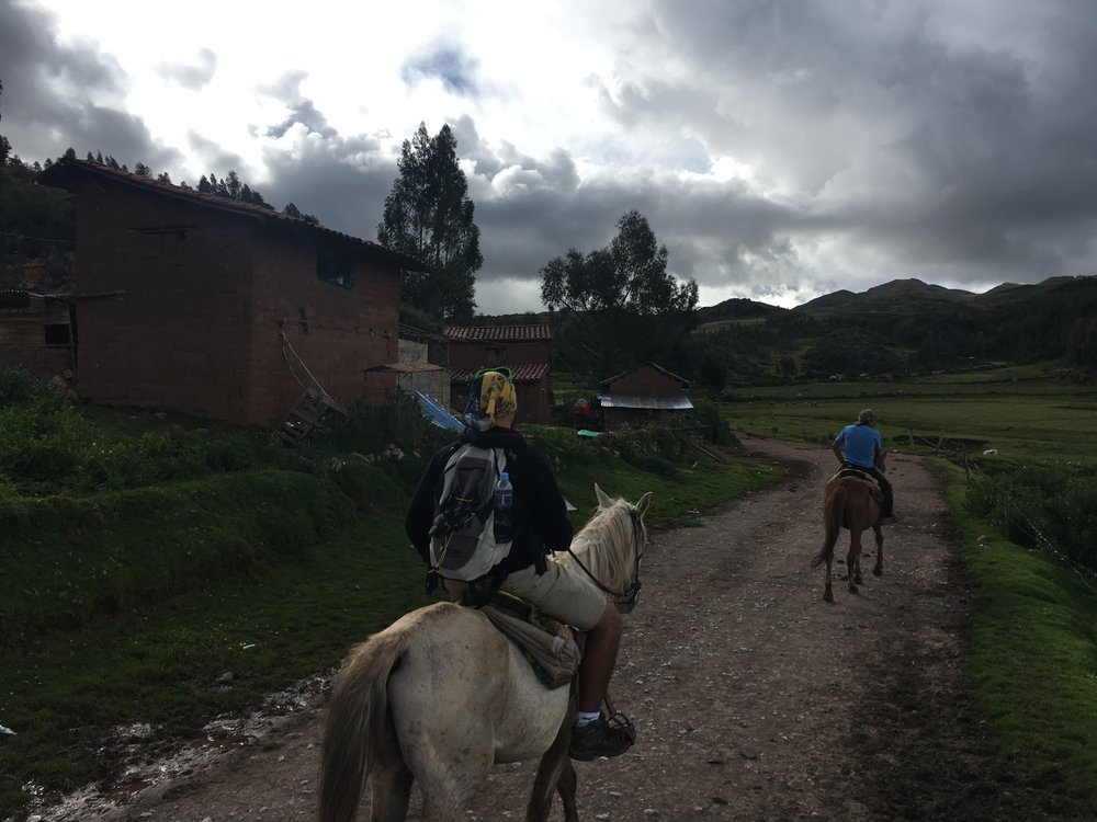 Riding horses up to the Sacsaywaman ruin. Clouds rolled in and it sprinkled for a few minutes before it cleared out.