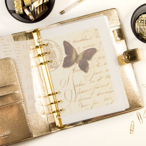 Planner 101: this ring-bound planner is a large gold Dokibook.