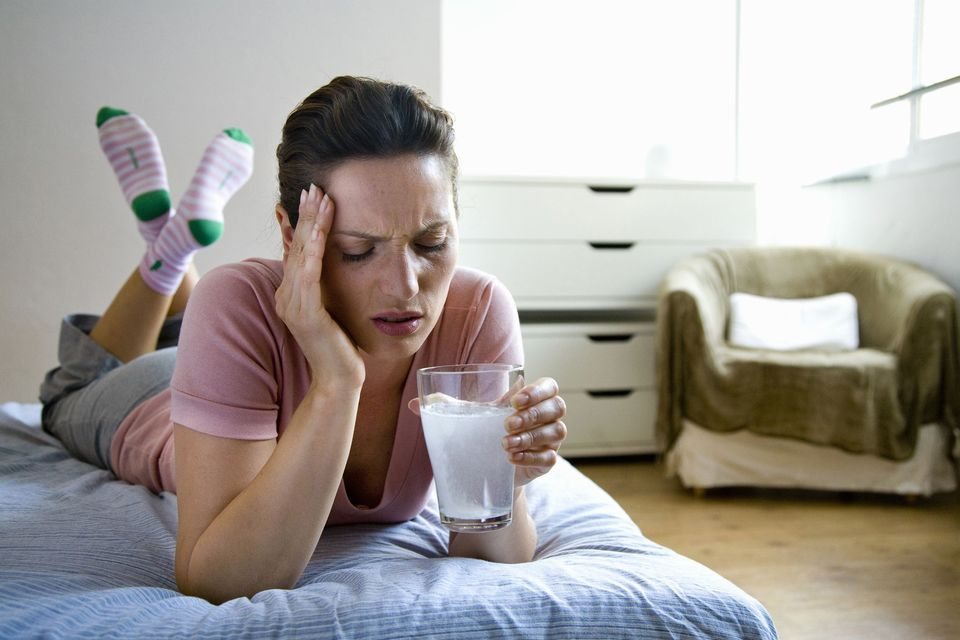 Woman-with-hangover-GettyImages-98680969-588f6a8a5f9b5874ee1e785e.jpg