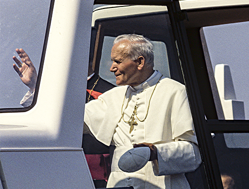Pope John Paul ll making his way through crowds in the Popemobile. © Greg Vivash