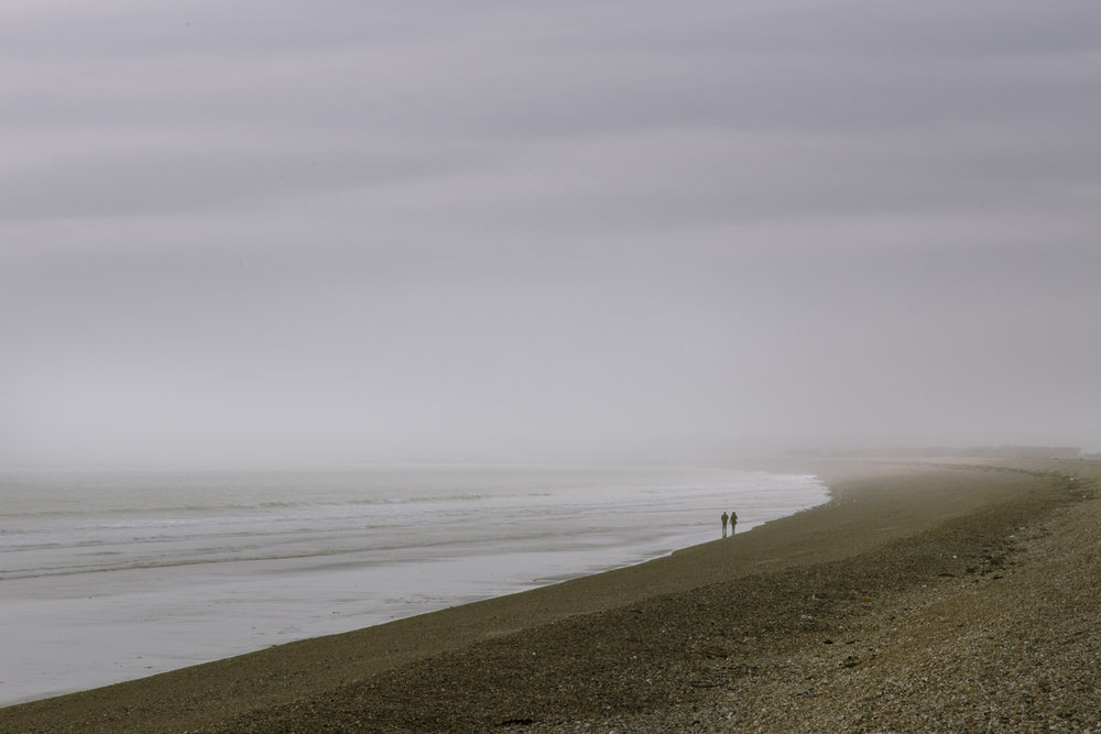 Misty beach couple