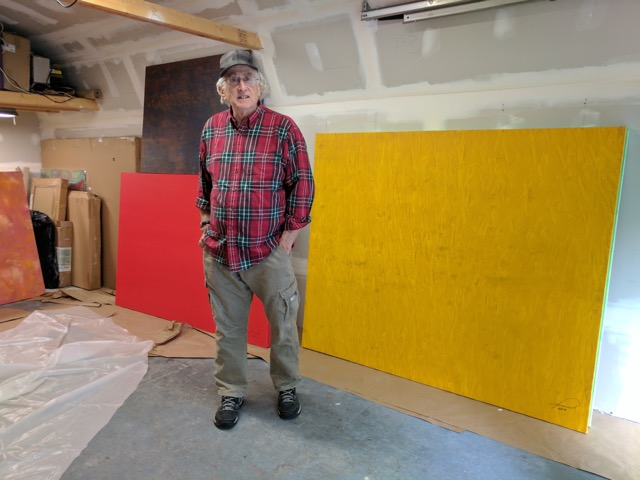 Stanley with paintings from 2017 Collection