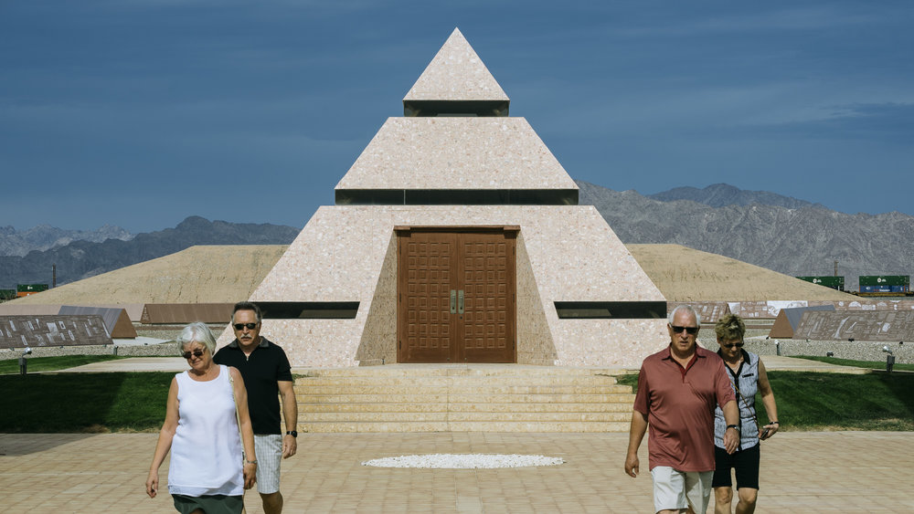 IMAGE CAPTION:  Canadian tourists at 'The Official Center of the World' a roadside attraction in Felicity, California, less than 5 miles away from the Andrade Port of Entry.