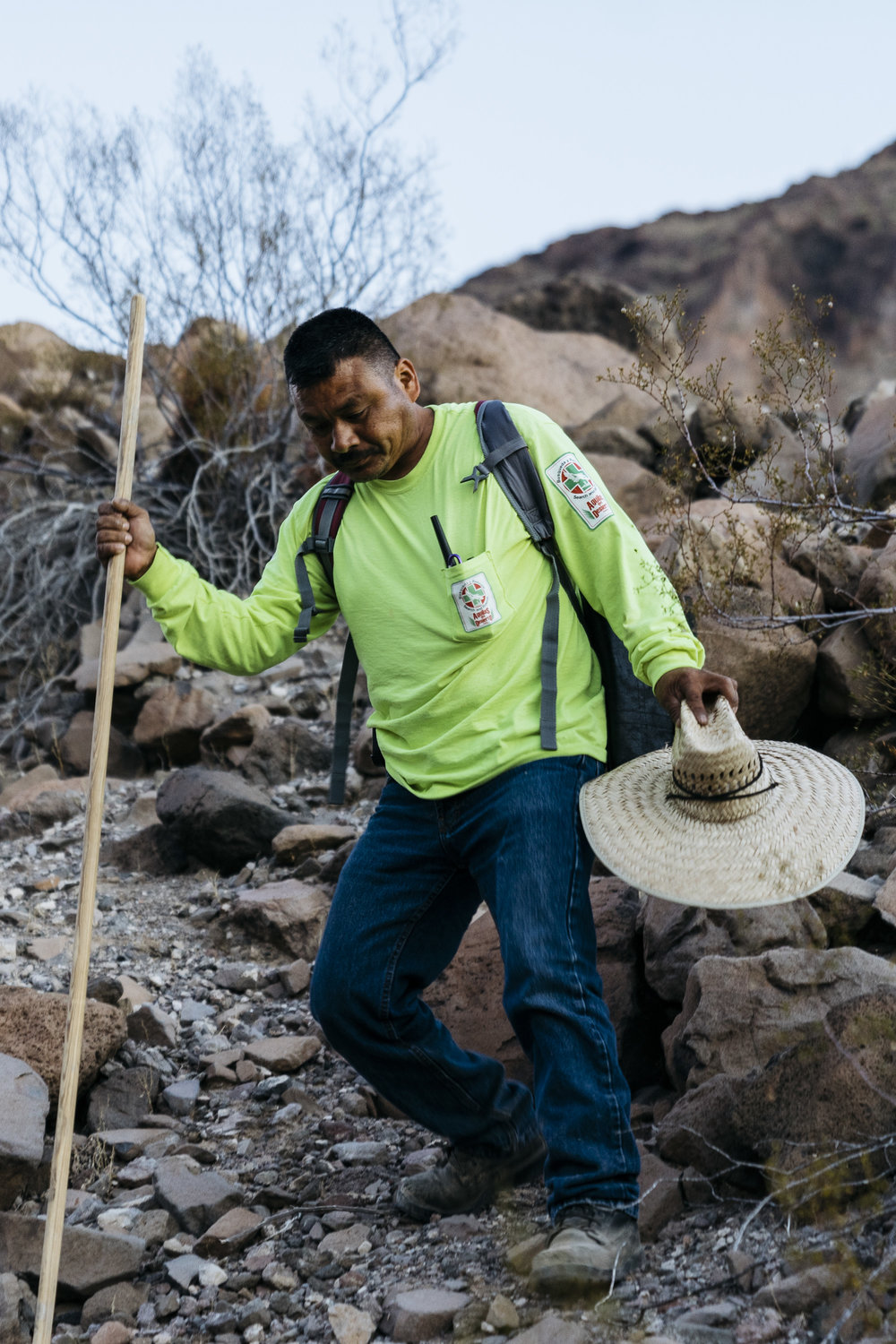 IMAGE CAPTION:  Maro Martinez, a volunteer with Aguilas Del Desierto, descends a wash in the Cabeza Prieta National Wildlife Refuge. Summer temperatures in this part of the Sonoran Desert can reach 120°F.