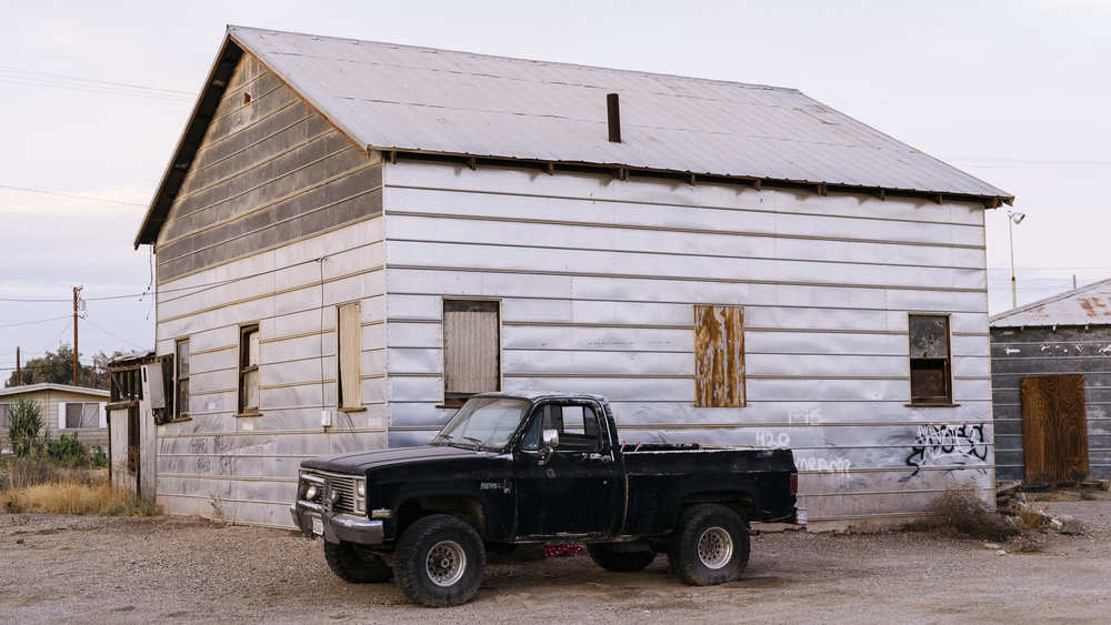 IMAGE CAPTION:  A truck parked outside an abandoned home in Niland, California. 40 miles from the Calexico Port of Entry.