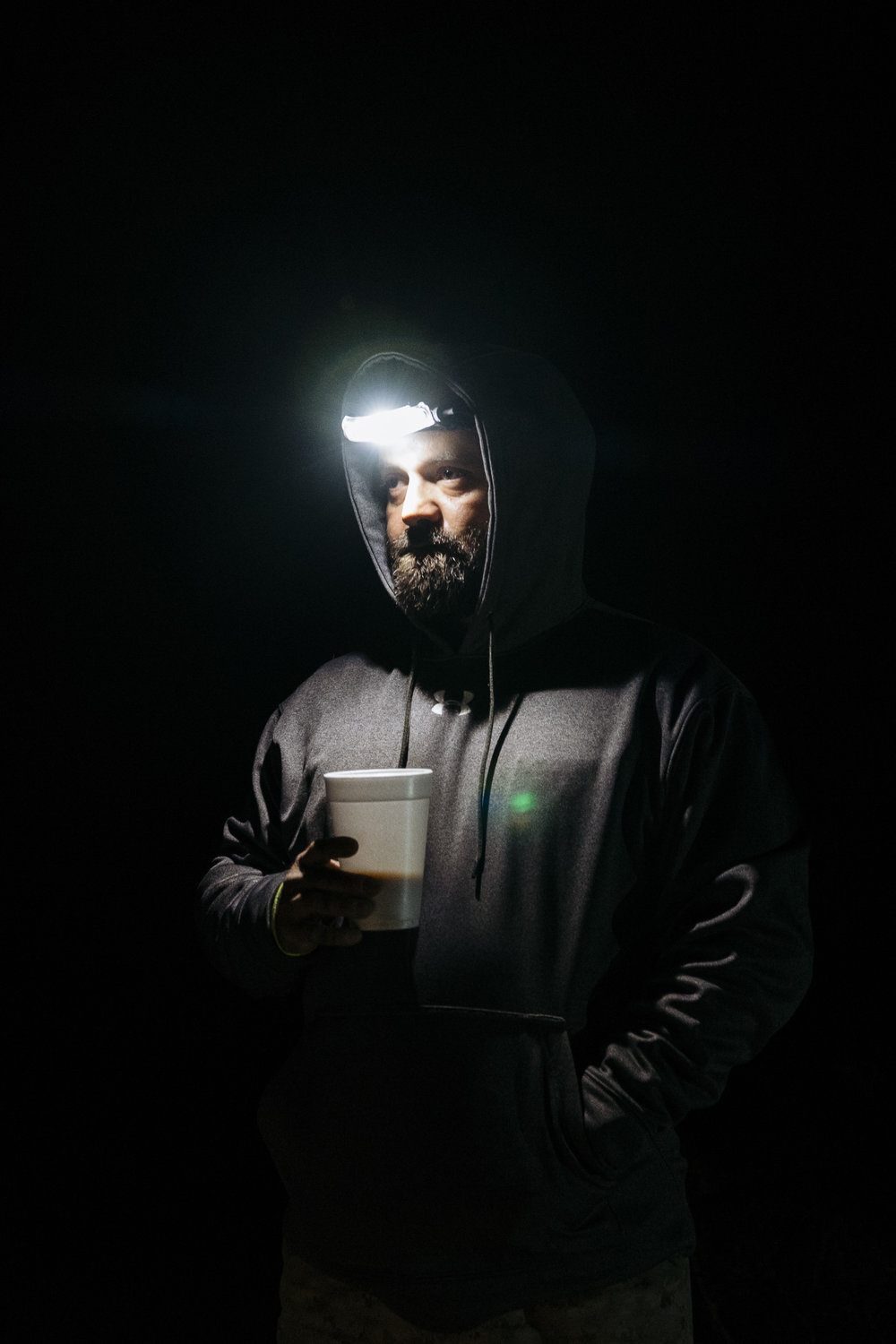 "IMAGE CAPTION:  Aristotle Barbosa, a Marine Veteran, prepares at 4 AM for a day of searching the Sonoran Desert for deceased and lost migrants with Aguilas Del Desierto. ""The landscape reminds me of Iraq, minus the cactus,"" says Barbosa, who saw three deployments there."