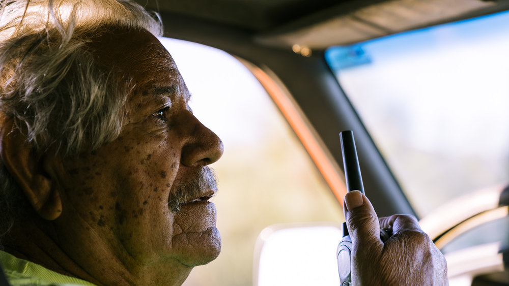 IMAGE CAPTION:  Vicente Rodriguez communicates with his team by radio while driving a 4x4 into the desert carrying supplies and volunteers for Aguilas Del Desierto. He has been involved in immigrant to migrants search and rescue efforts since 2009.