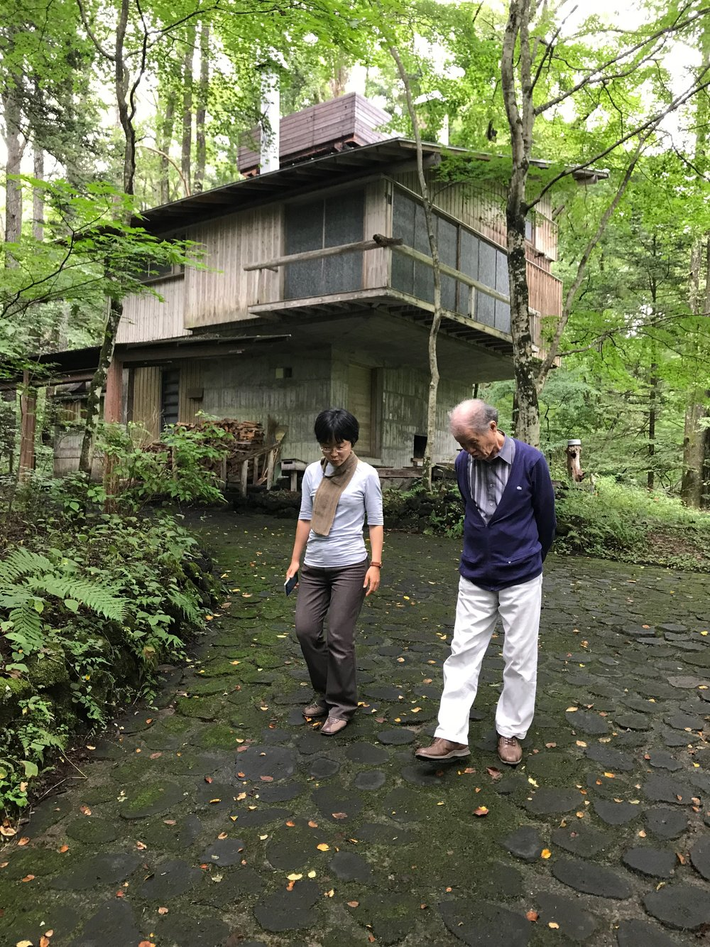 """Maki Utsunomiya and Mr. Kitazawa in Karuizawa at Yoshimura Sanso, the summer house of Raymond protégé Junzo Yoshimura. Maki gleefully pointed out, """"every architecture student in Japan is required to draw and build a model of it!"""""""