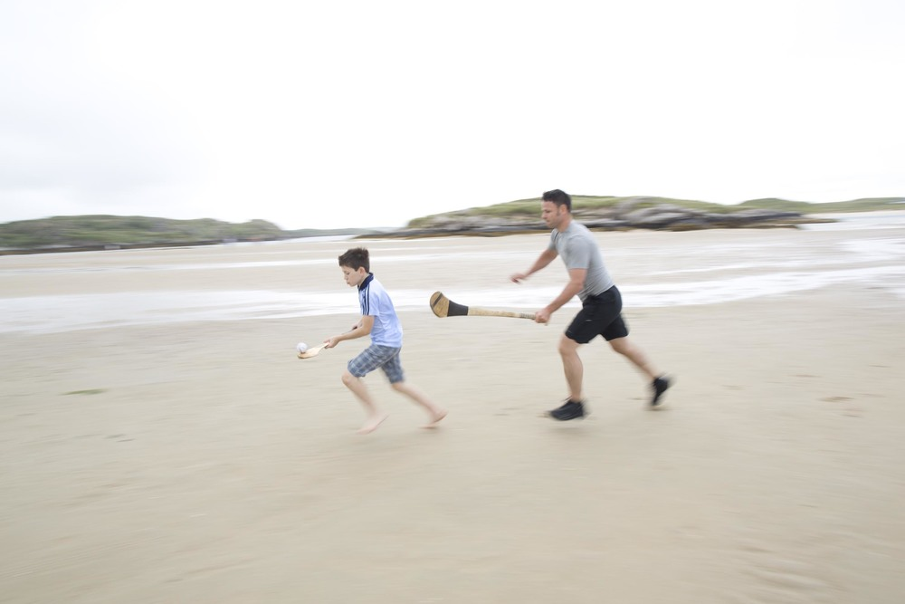 Playing the irish sport of hurling with eamonn in ireland