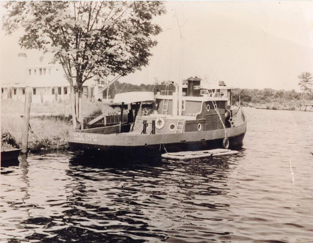 Motorized Hattie Creef tied alongside what is now Jennettes