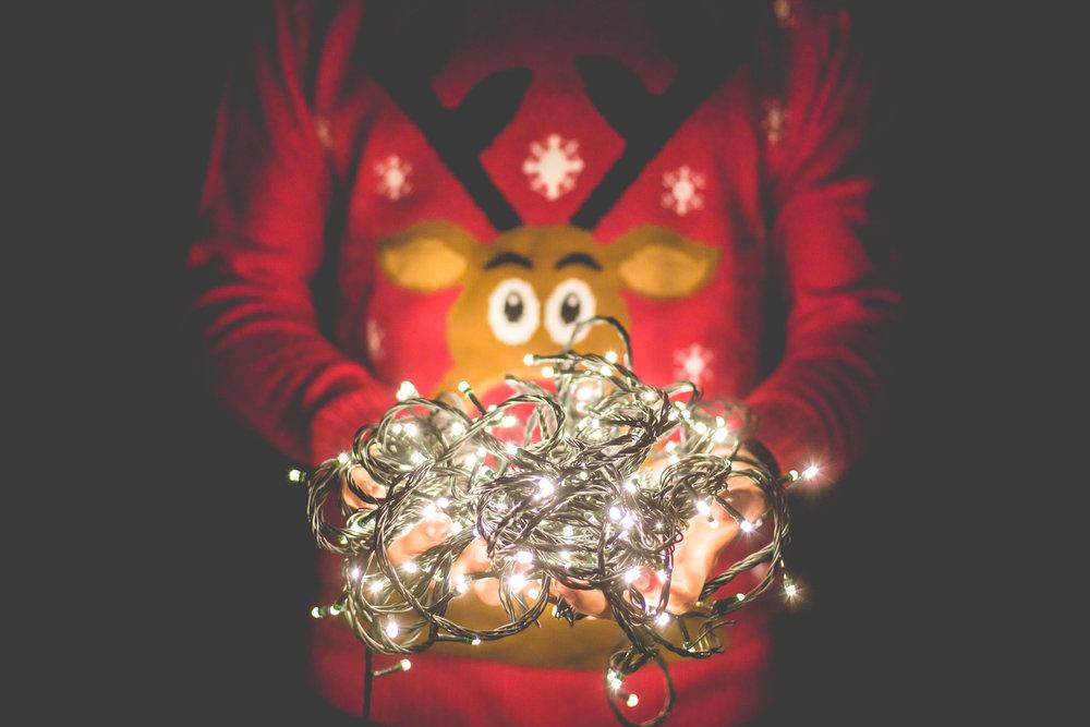 man-in-christmas-sweater-holding-christmas-lights-picjumbo-com.jpg