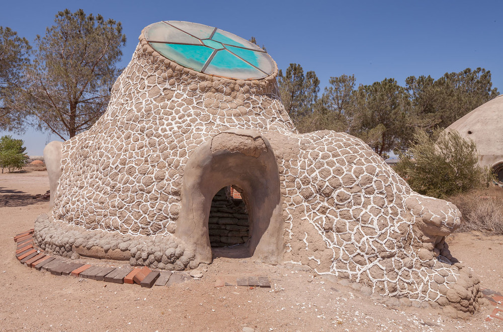 california institute of earth art and architecture. experimental earth-bag dwelling. hesperia, ca.