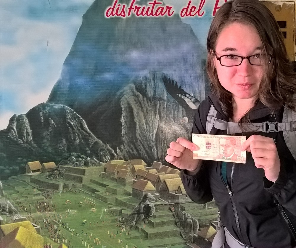 Holding Peruvian money (soles)