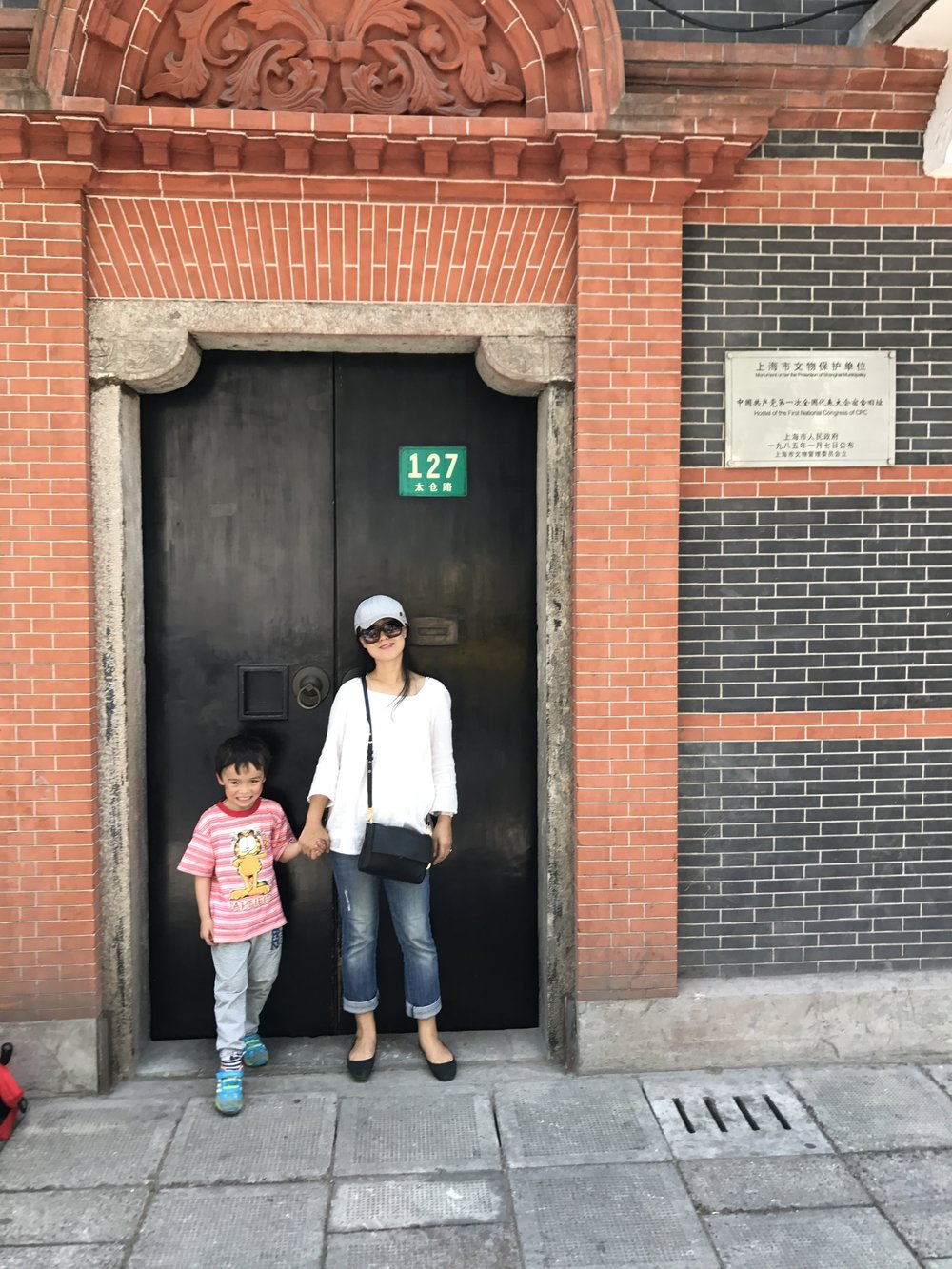 Five years old decided to take this photo with me in front of the gate of Hostel of First National Congress of CPC ( Communist Party of China).