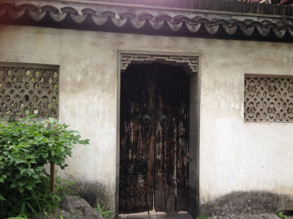 An pair of old wooden doors inside of Yu Garden(built in 1559 in the reign of Ming Emperor JiaQing)