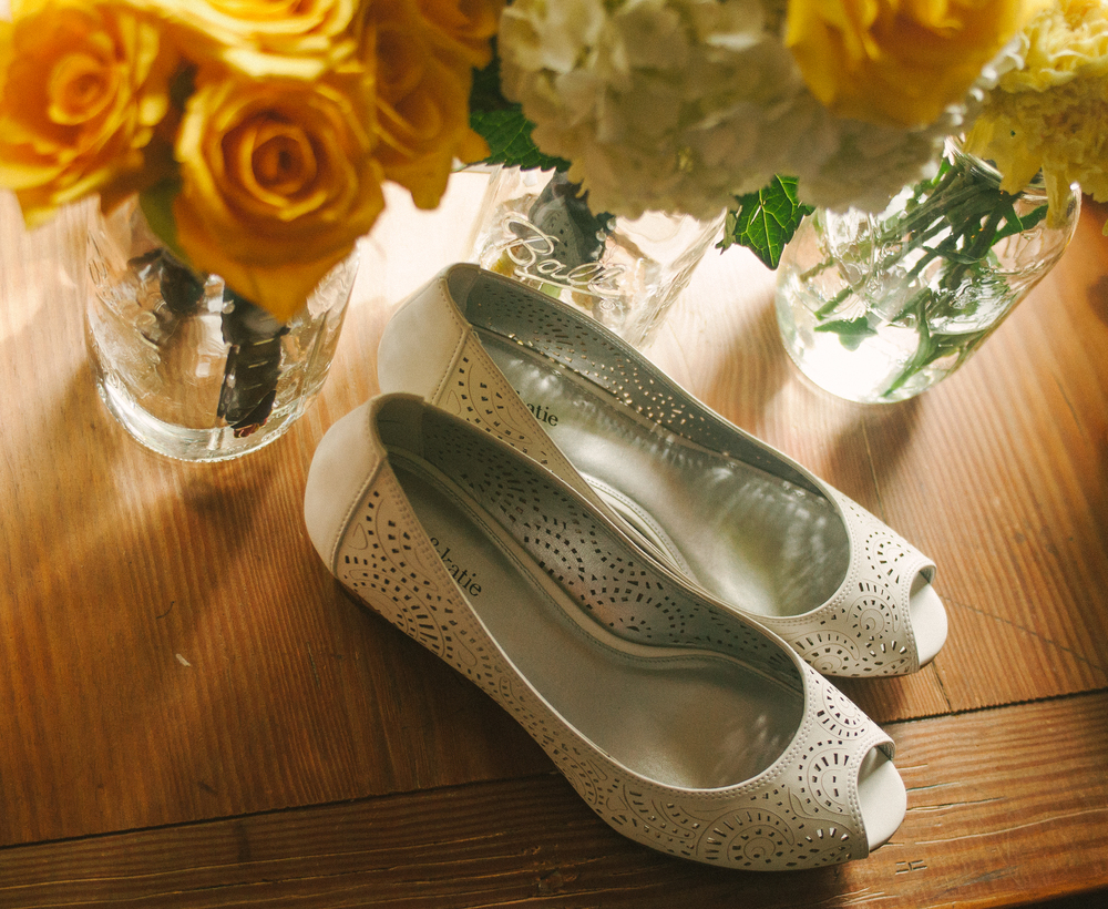 wedding-natural-light-photography-still-life-flowers-shoes-yellow-roses-digital-long-island-wedding-photographer.jpg