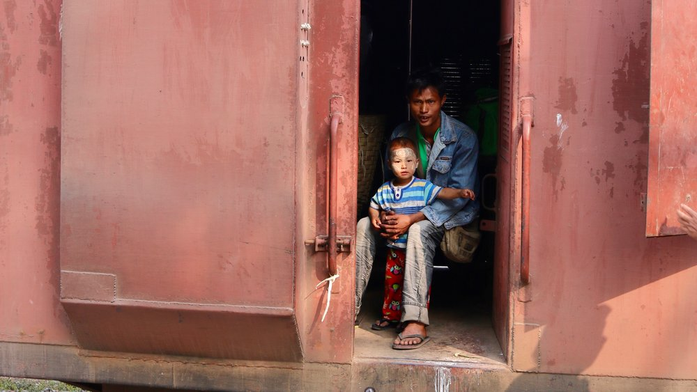 Complete guide to Hsipaw, Myanmar. Boy and father on train, @acrosslandsea