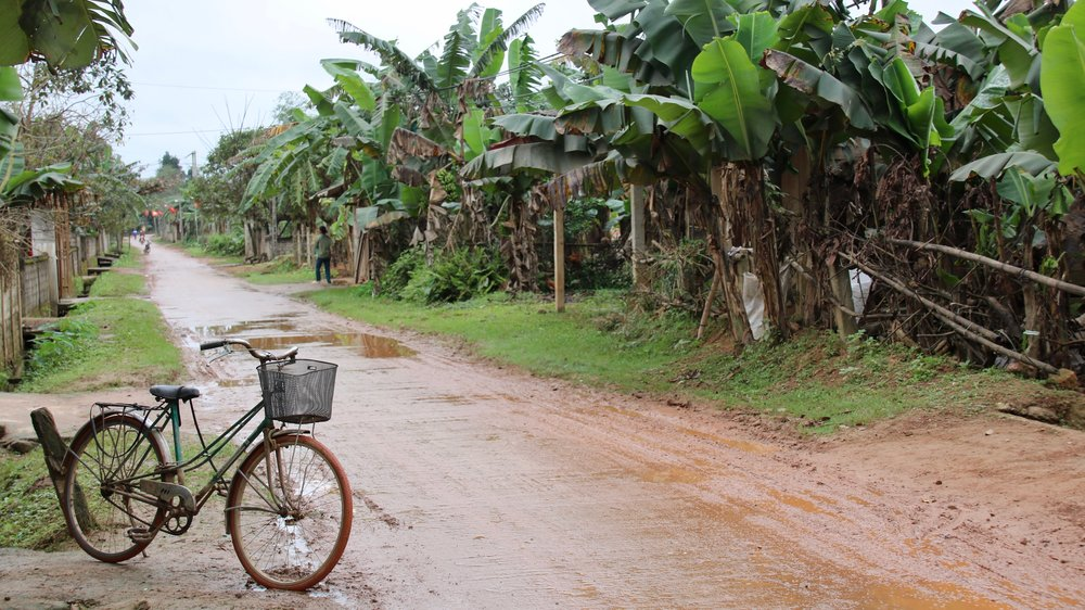 Why I love Phong Nha - bike on muddy street