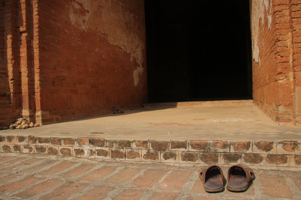 Myth-busting Myanmar: thirteen misconceptions and the truth behind them. Shoes outside Bagan temple