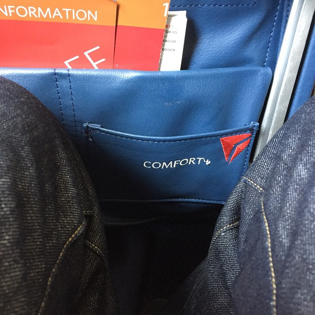 What is the very last word that could describe flying in coach? Let's embroider that on the seats. (at Delta Terminal - LaGuardia Airport)