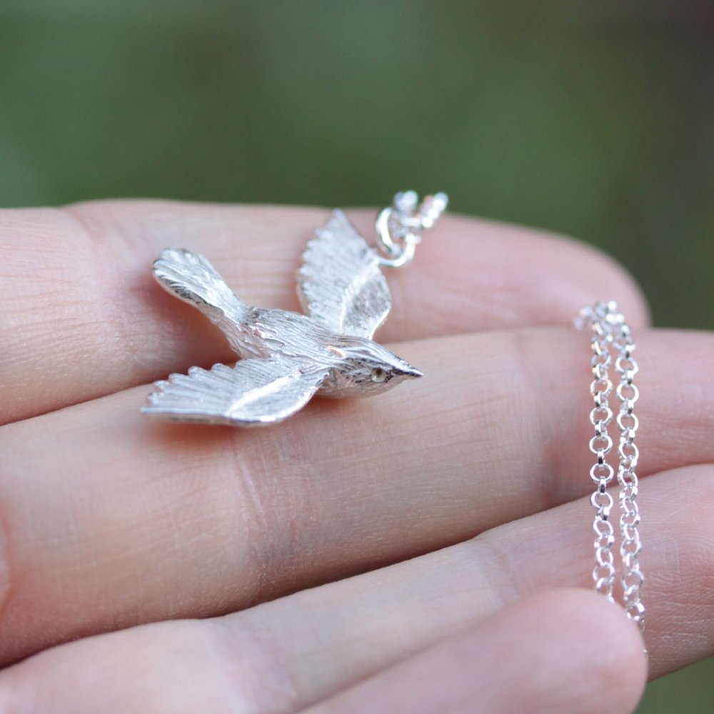 "A little wren necklace was commissioned for our customer's Granddaughter's birthday; her middle name meaning ""wren"" in Irish."