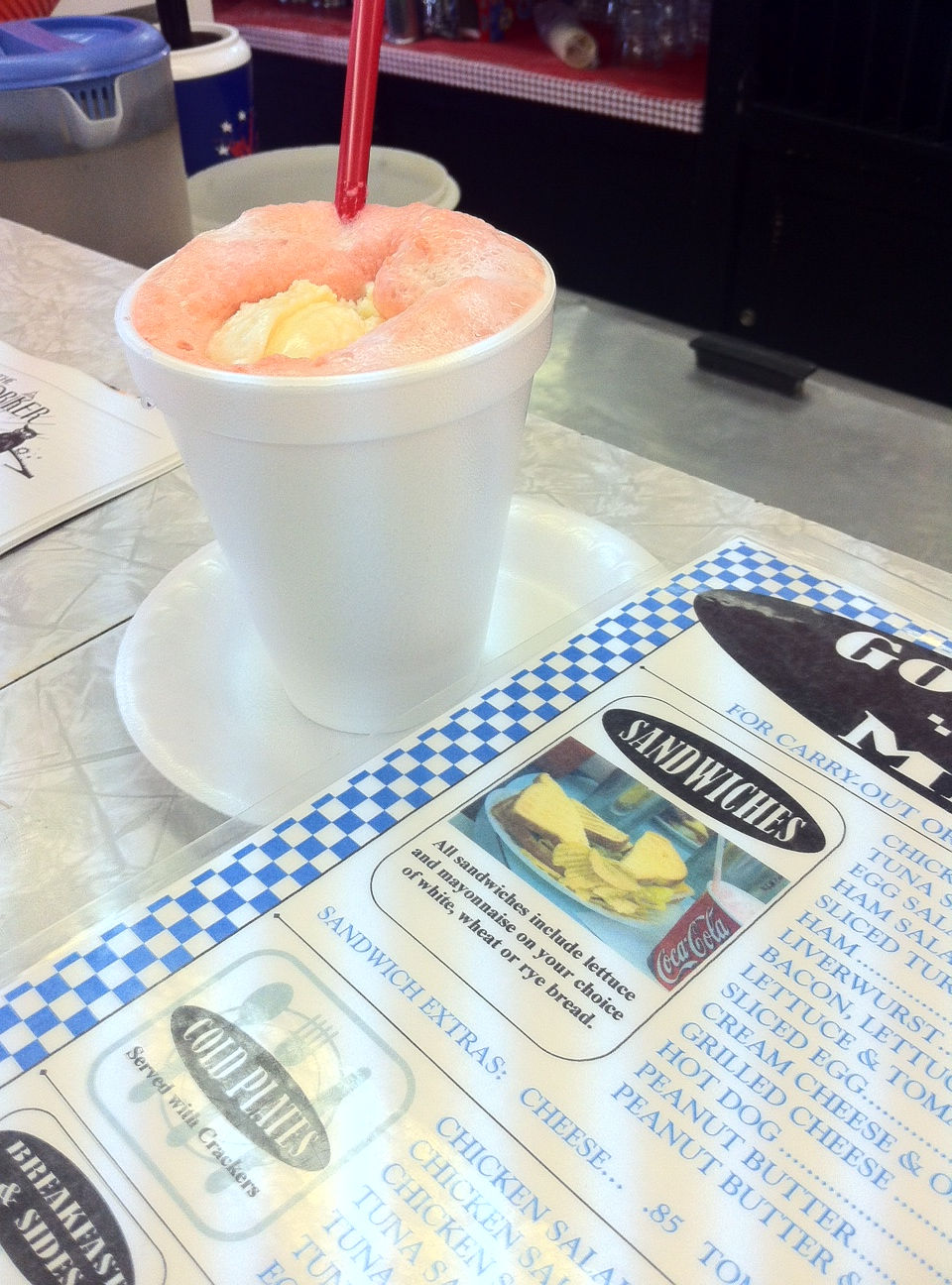 A strawberry soda (strawberry syrup, soda water and vanilla ice cream) from Goolrick's