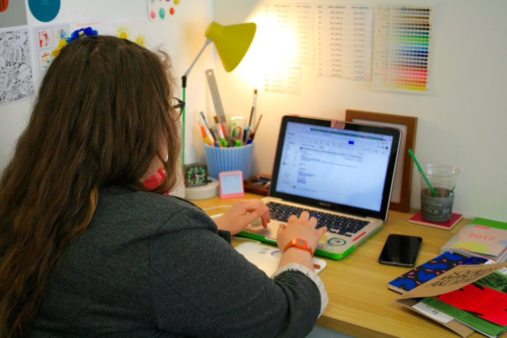 Rachel Littlewood at work on her desk