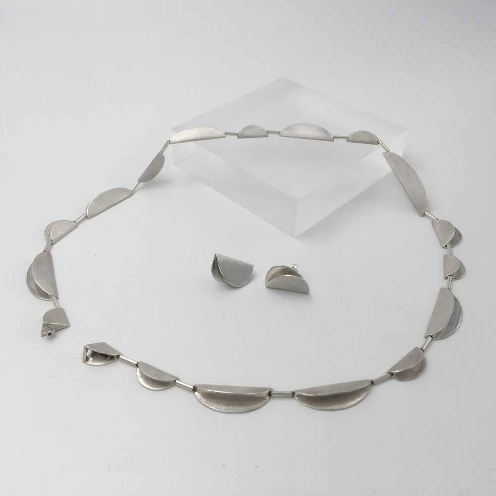 Esme Tanner - @esmetanner_jewelleryEsme is a contemporary Jeweller & Silversmith. A recent graduate of Bishopsland, she incorporates hand engraving and enamelling techniques into her modern and wearable pieces.