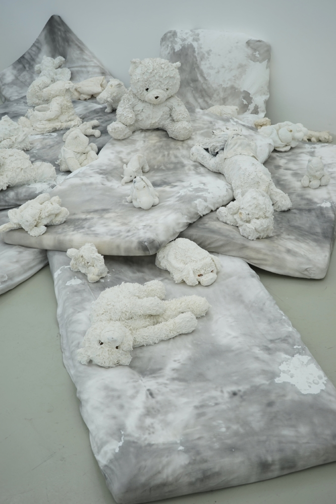 The Raft of the Teddy Bears, 2017, detail of the Installation (porcelain sculptures, mattresses, Chinese ink),  variable dimension
