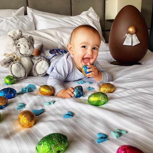 Ummmm cheeky boy they're not all for you! 😂👑🥰 #babyboy #easter @westinmelbourne He's loving the bed and sheets I don't think we can take him home 😂🐣👶🏻 #cheeky