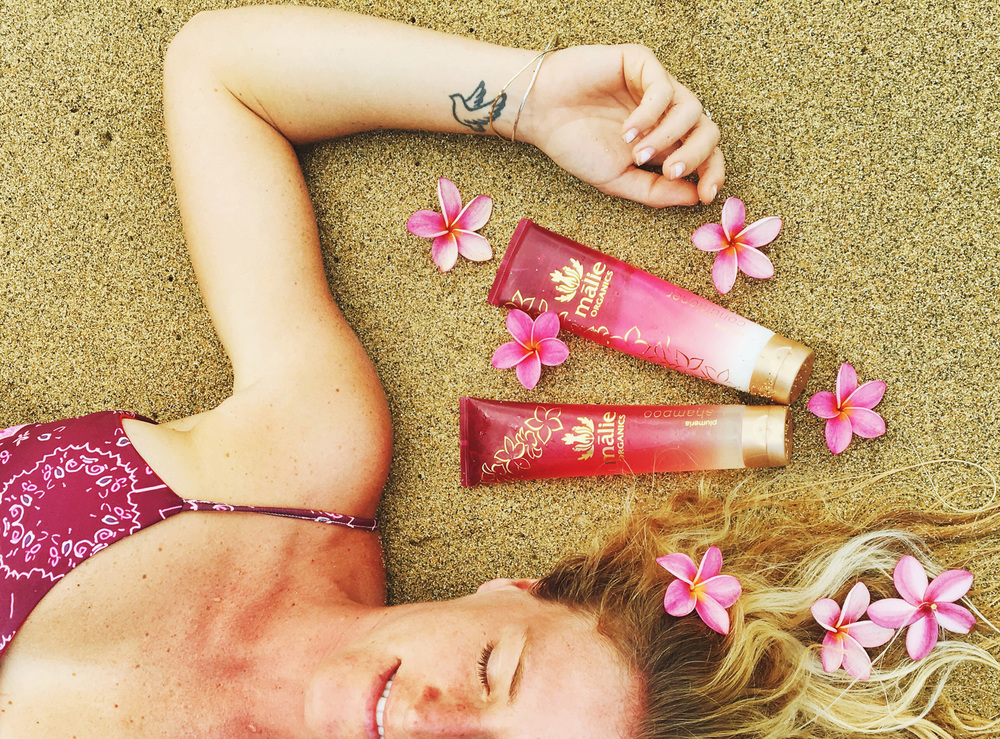 Swimming in a sea of plumeria with my Malie Organics
