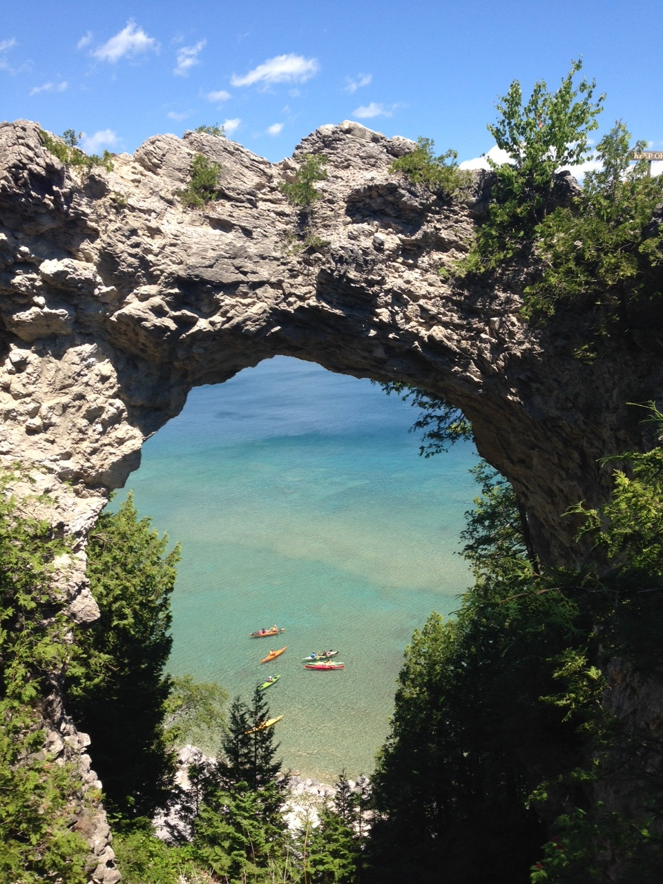 Arch rock with a view of the amazing colors of both lake and sky