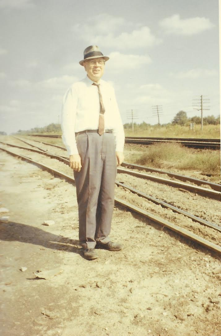 Not a childhood photo but it reminds me his always present hat and railroad ties.