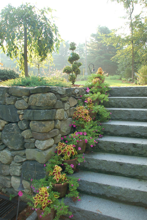 Granite steps and fieldstone wall in Westford