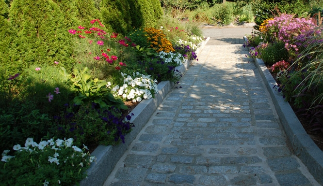 Cobblestone Walkway with Granite Borders and Planter Beds