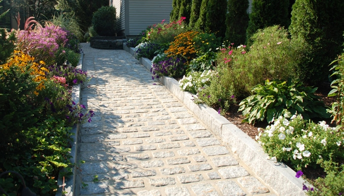 Cobblestone Walkway with Granite Borders and Annuals