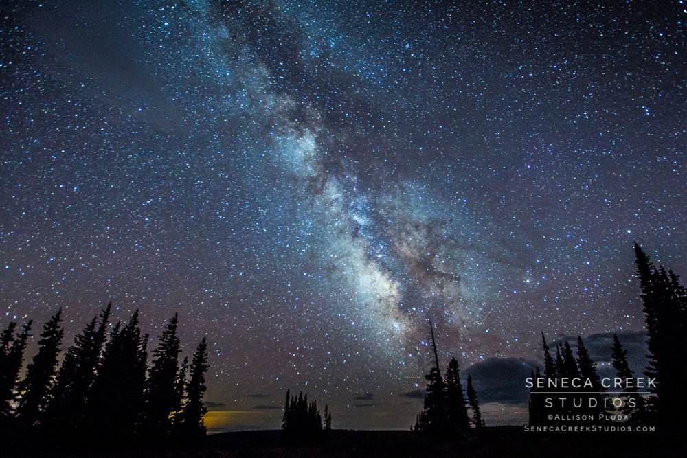 """The Milky Way during the Perseid Meteor Shower and the Glow of Laramie, Wyoming, Snowy Range Mountains, Medicine Bow National Forest, ""16x24, Fine Art Photograph on Metal by Allison Pluda / Seneca Creek Studios"